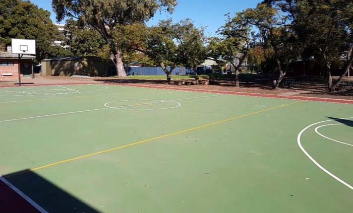 cleaning of acrylic basketball court at a school